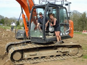 A man and woman on a digger